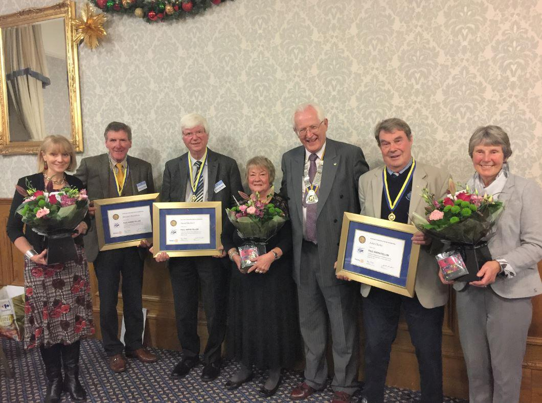 New Paul Harris Fellows in Claverhouse - President Ivor with the three new Paul Harris Fellows and their wives