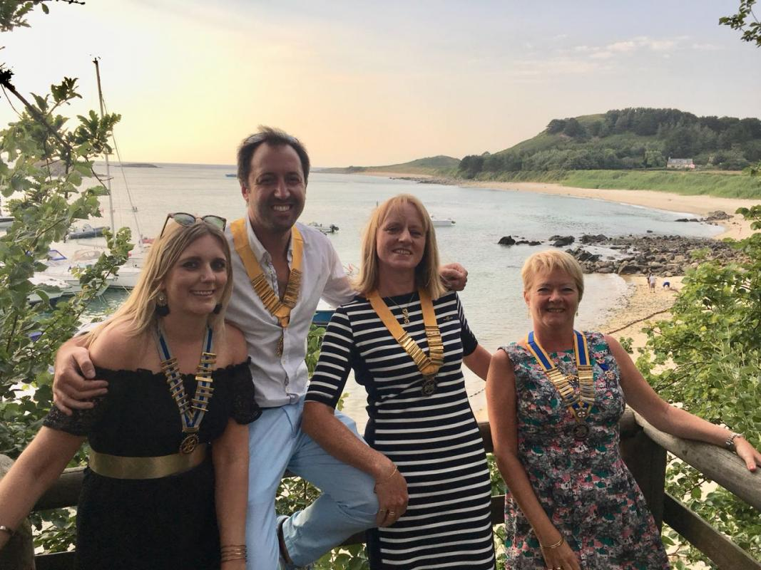 Club officers 2018-19 (Aimee, Mike, Jo and Sarah) in Herm celebrating the end of the Rotary Year and hand over of offices.