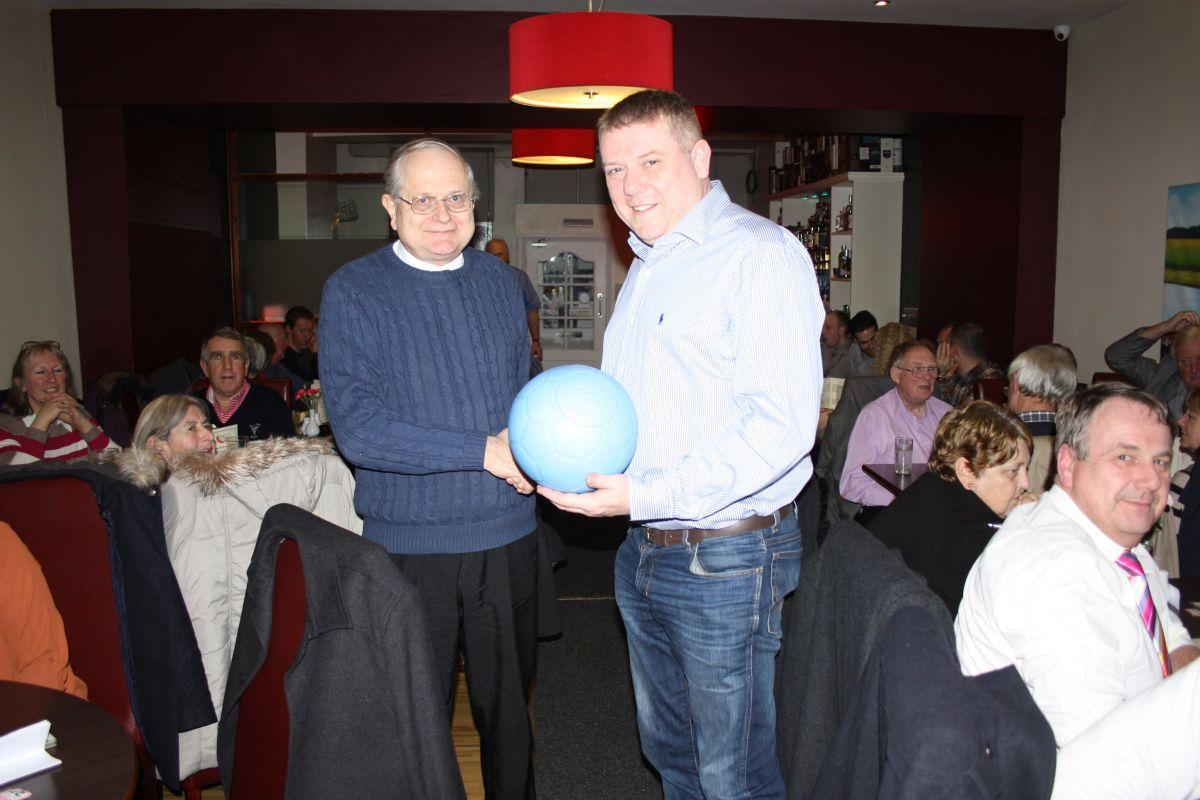 Comedy and Curry Night 2016 - David Aimer, Chairman of the Community Committee presenting to Gary Ingham of Bishop Auckland Scouts the Oneworldfutbol that was crowd funded