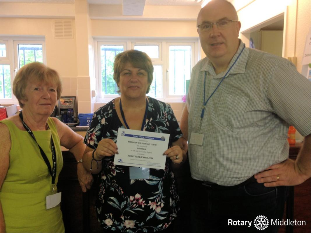 Carole Hill (centre) receiving the cheque from Rotarians Janice Powell and Ged Heatherington