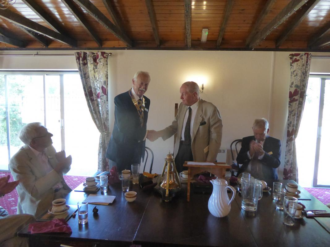 The induction of Roger by Past President Owen Pinney