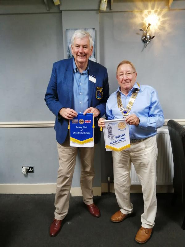 DG Patrick Tyrrell and Bury Club President John Cooper are about to swap Club Banners
