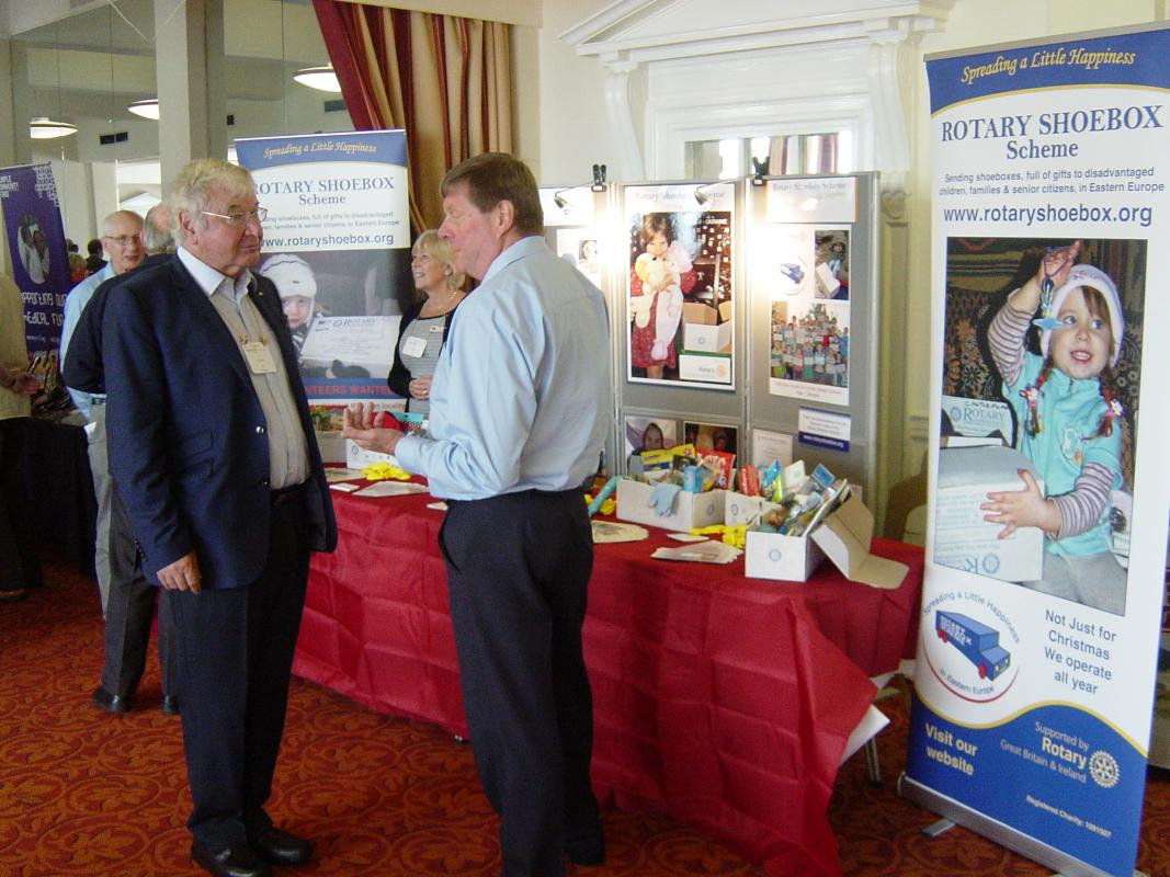 In the foreground Bury Rotarian Nigel Danby discusses with Past District Governor Colin Incet the Rotary Shoe Box scheme whilst in the background Peter Clare chats to Past District Governor Stan Bowes watched by fellow trustee Mrs Gill Danby