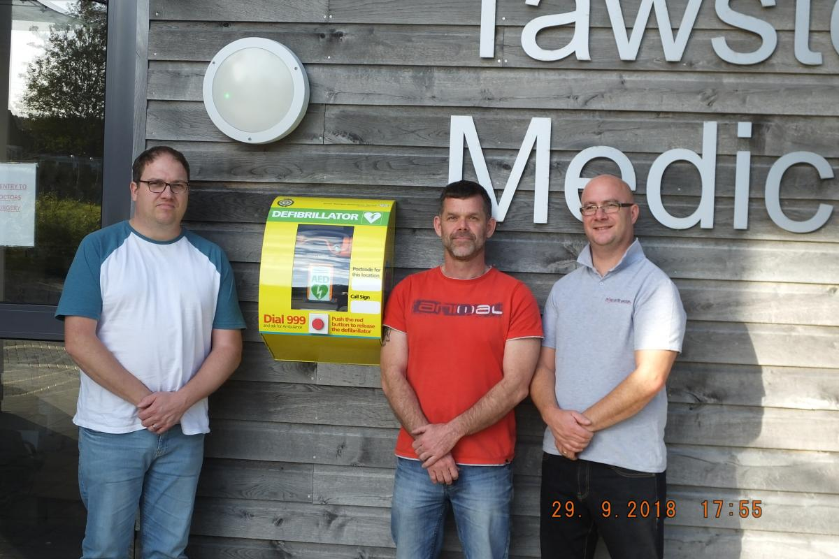 NEW DEFIBRILLATOR HANDED OVER - Club President Mike Trott hands over a defibrillator to Tawstock Medical Centre.