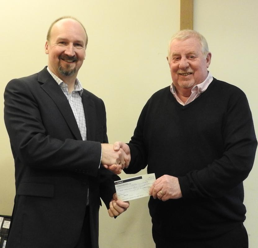 Berin Riley, last year's president, chose the Samaritans as one of our charities to support.  Here he hands over a cheque to John Aitken.