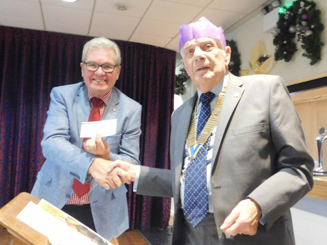 Christmas Lunch and Message from Past President Rev Roger Woodward - A cheque for Macmillan Nurses presented to Roger.