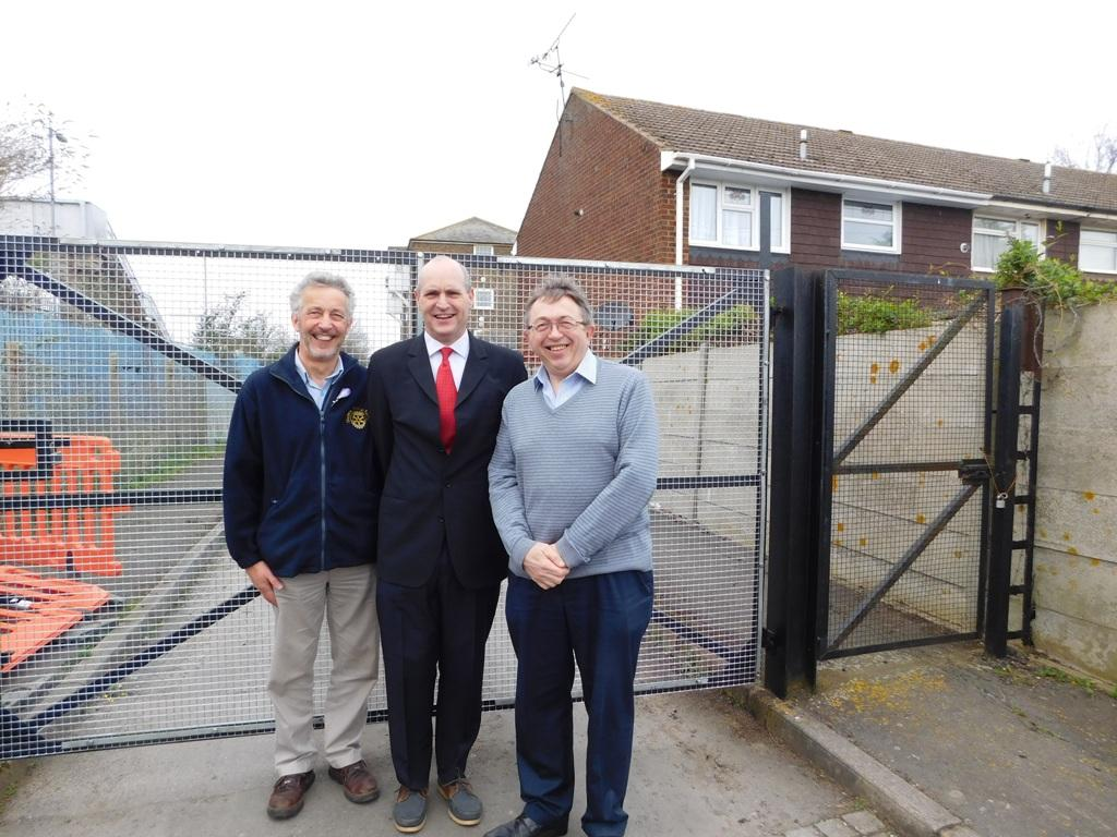Phil Taylor, CEO of ArclorMittal Kent Wire Ltd standing in front of the finished gates with Rotarian Bill Parkinson and Paul Clark from the Community Centre.