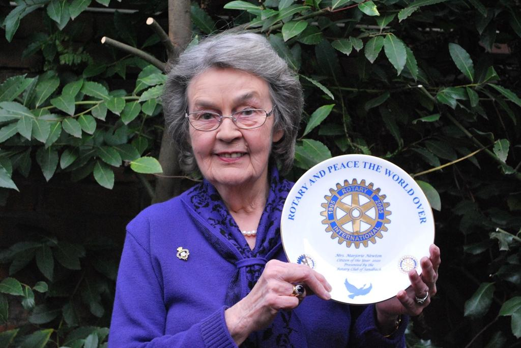 Delighted  Mrs. Marjorie Newton displaying her award