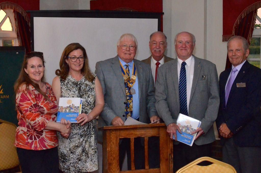 Business Meeting/Club Assembly - MFH - New Members Hazel and Peter with their sponsors; Club President Tom; and Assistant District Governor Howard