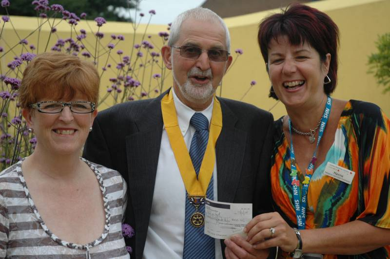 Our picture shows Senior Vice President Martin Keable, presenting a cheque for £422, to Maxine Taylor, who is the Centre's chief fundraiser on the right and Roberta Lovick who is the mother of Louise Hamilton after which the Centre is named