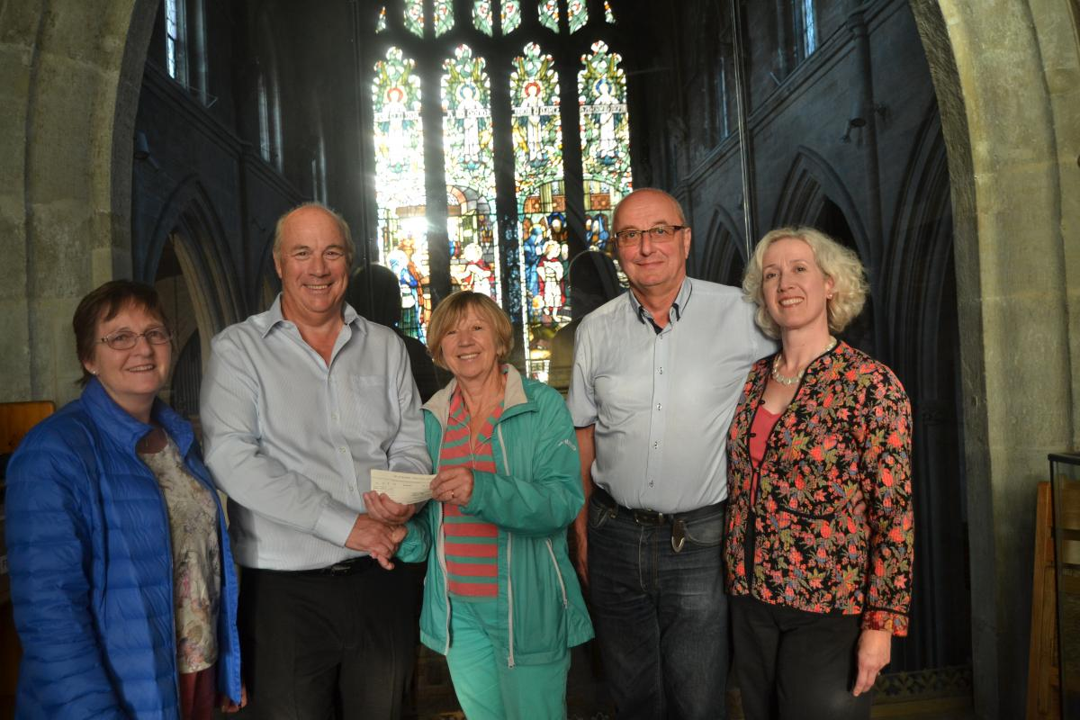 Musical Gala evening,  - Pictured here with a cheque for £2,304 which was raised in aid of Cancer Research UK are Susie Barton, Rotarian Vic Clarke, Kay (Richard's wife), Barry Day and Clare Macourt.