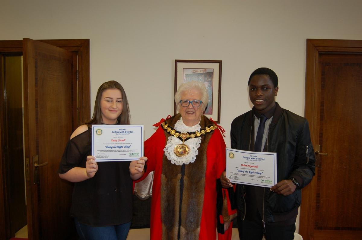 Mayor of the City of Salford with two recipients of their