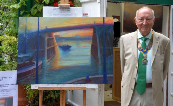 Local artist raffles for Nepal - Jim Stevens, Club President 2014-2015 with the painting 'Sanctuary'