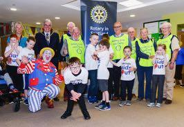 Pictured with the staff and children are, from left to right, Deputy Provost Graham Ross, Rotarians Graham Hay, Stuart McCallum, Club President John Considine, Sandy Renfrew, Noelle Murphy, Ormond Smith and, of course, at the front, Bubbles the Clown.
