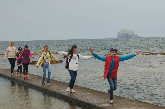 Chernobyl Children Visit - Children on the boating lake wall head for the beach