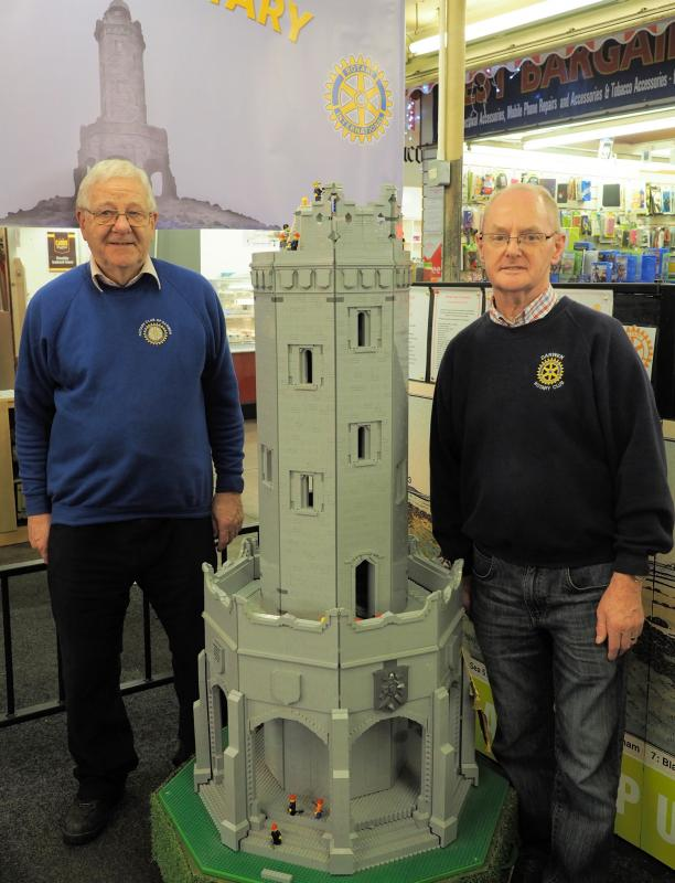 Rotarians John Jacklin and Alan Slack with the Logo Tower as we start the dome and battlements.