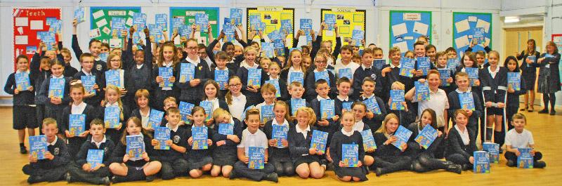 The dictionaries get a big thank you from the children at one school.