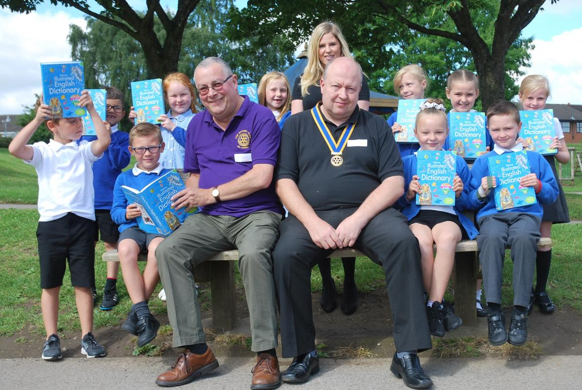 Rotarian Tony Sargeant and Club President Paul Tinker pictured with students at South Parade Primary School following presentation of their dictionaries.