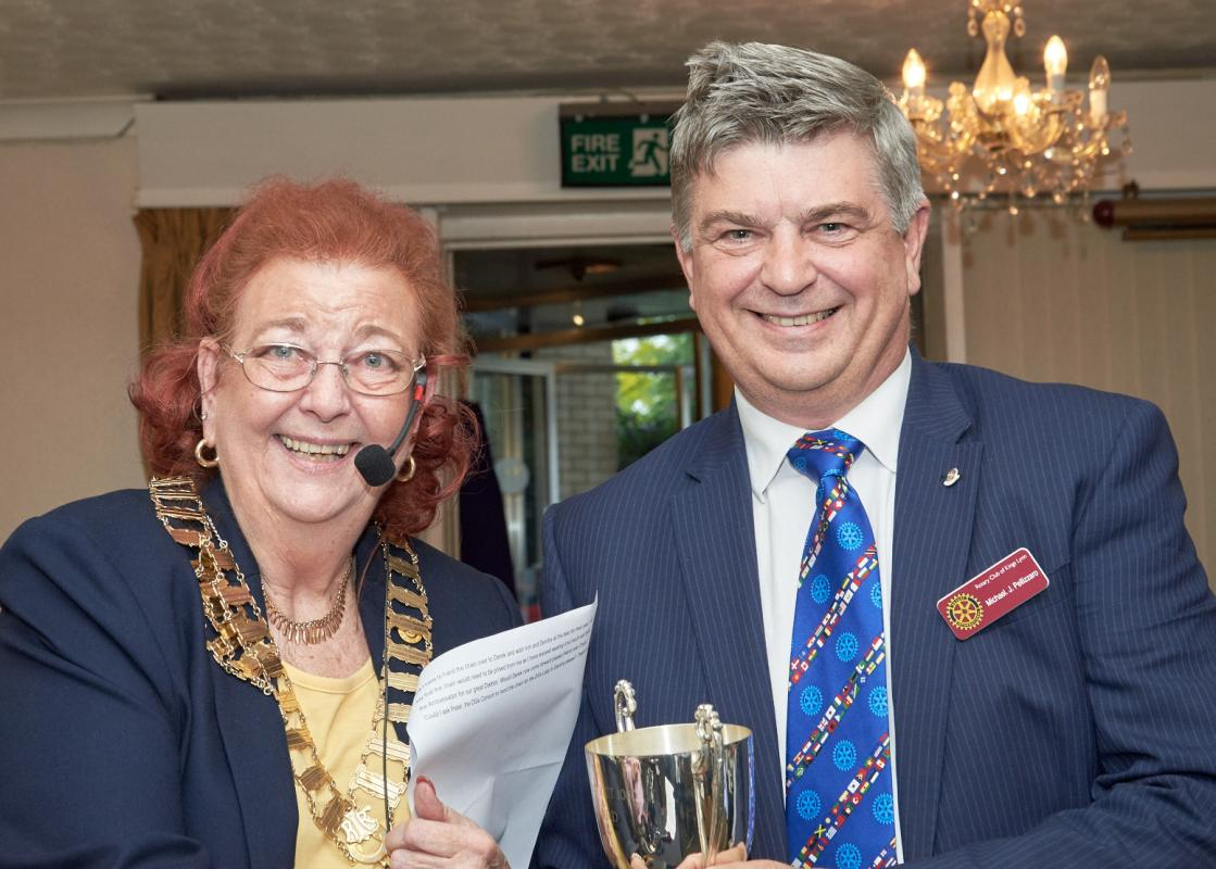Dorothy Pulsford-Harris presenting the  P.R. Cup to Michael Pellizzaro, President of the Rotary Club of King's Lynn.