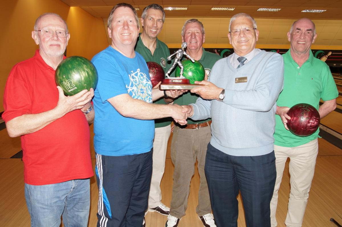 Kirkham Rotary ten pin bowling District Champions 2016 - The team being presented with the District Trophy by Assistant Governor Miles leadbeater.