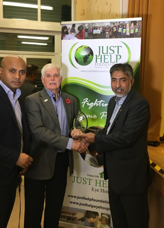 Just Help Achievement Award Presentation Evening - Past President Andy receives a life time award from Chairman of Just Help Foundation, Mizan Rahman.