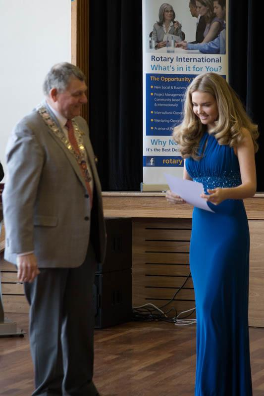 Jasmine Bingham receiving a certificate from the Regional Governor