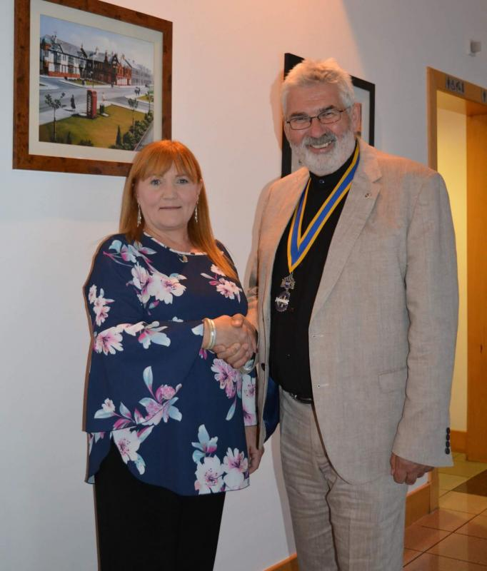 Fiona is seen here with President Ian Geddes