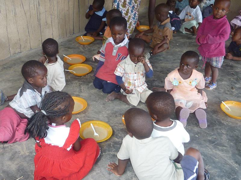 Our on going project in Malawi has ranged from bridges over the river to feeding stations for these  children.