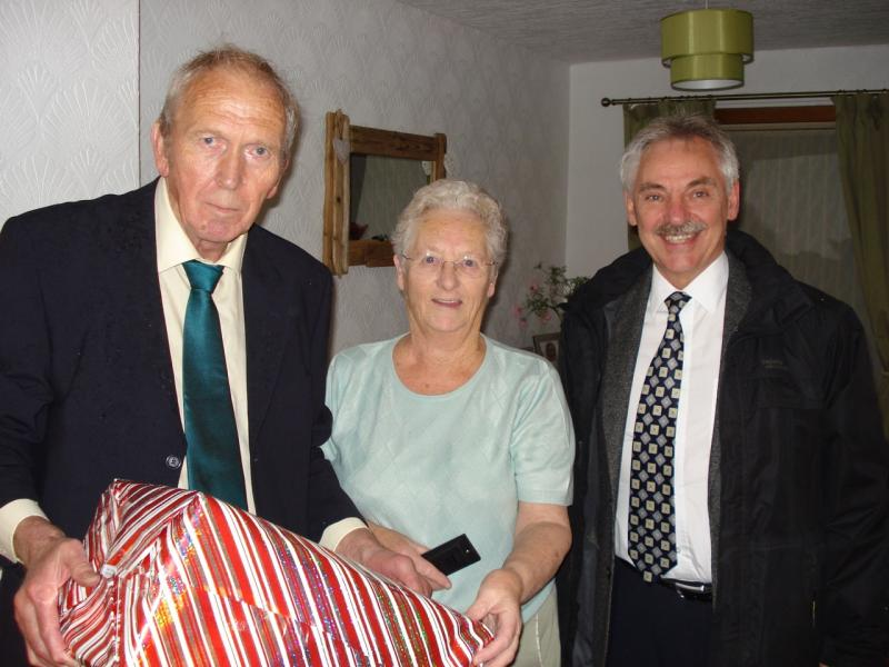 Thornhill Community Firework Display 2015 - Picture shows Christmas Hamper winner Mrs Wilson with Rotarian Chris Simmonds (L) and Rotary Vice President and fireworks technician Ian Morrison.