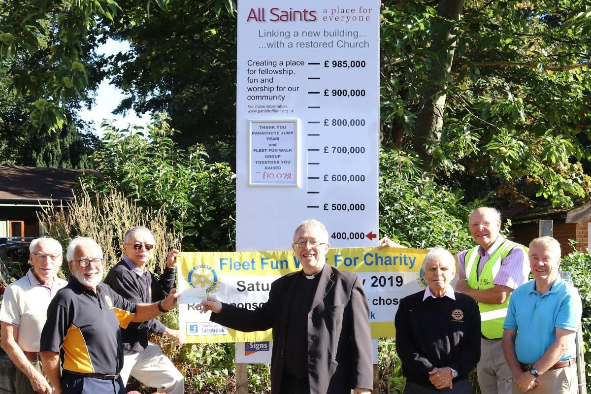 Vicar of Fleet Mark Hayton receives a cheque from Rtn Chris Johnson. This was raised from Sponsorship of those who walked in aid of 'Arise All Saints' appeal.