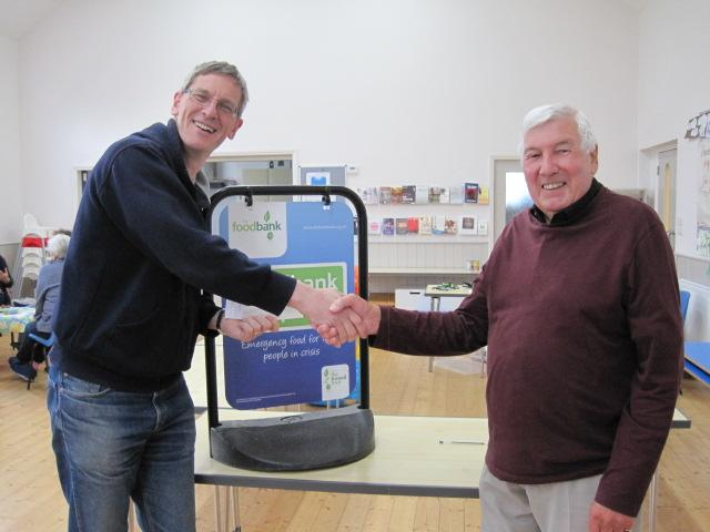 Community Services Chair Mike Bentley presenting a cheque to Ely Foodbank