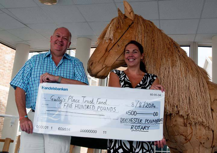 Visit to DCH to for Cheque Presentation for Gully's Place - Howard presenting a Cheque to Alison of Gully's Place