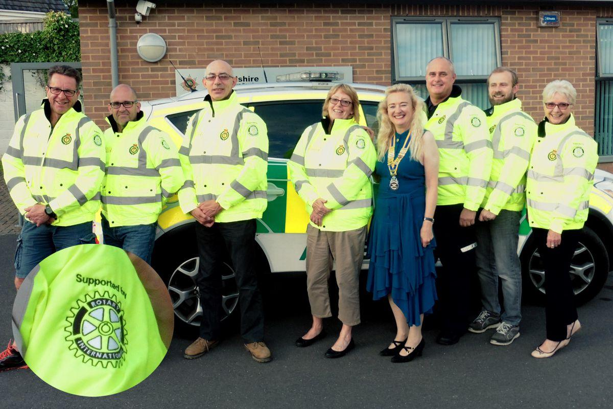 Gnosall First Responders show off their new jackets with Eccleshall Rotary Club President Sylvia Keris