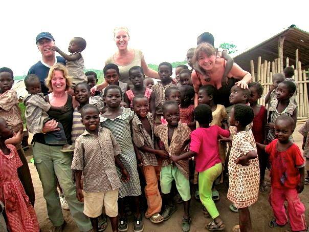 Ali Stone & Friends back from Ghana - Ali and volunteers with the local children