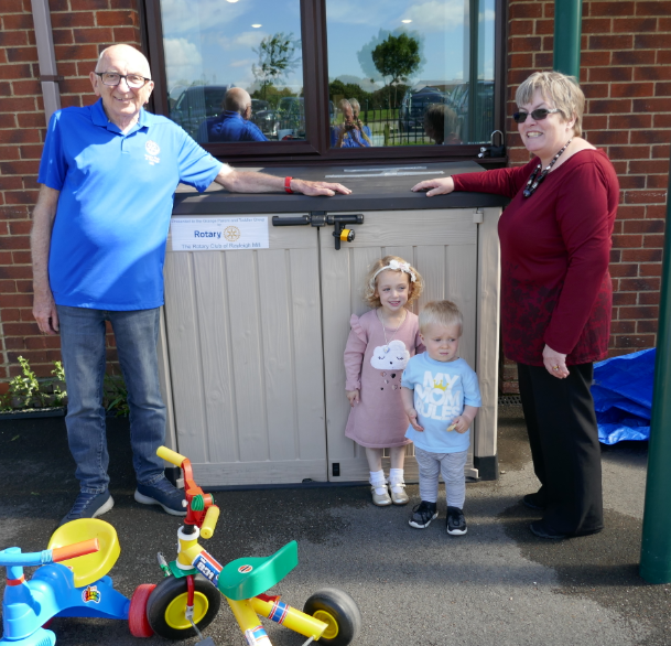 Rayleigh Mill Rotary Community and Vocational Committee Chairman, Bill Farmer and Christine Howard of the Grange Parent and Toddler Group with two of the group's members