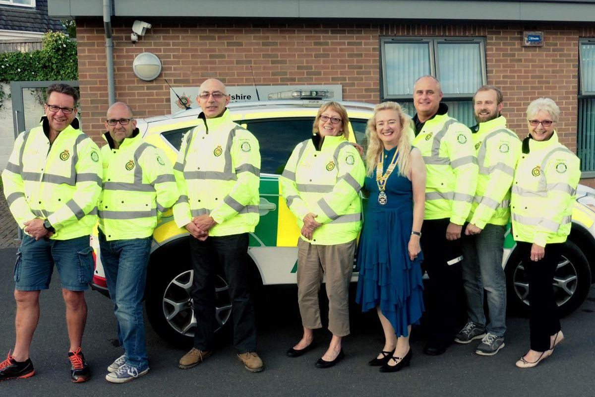 Gnosall Community First Responders wearing their new high viz jackets,  with Club President Sylvia Keris