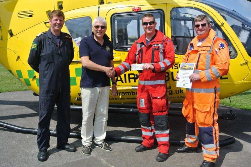 Basingstoke Loddon Rotary Club President, Ian Rosewell, presenting a £2,500 cheque to Crew Members of the Air Ambulance