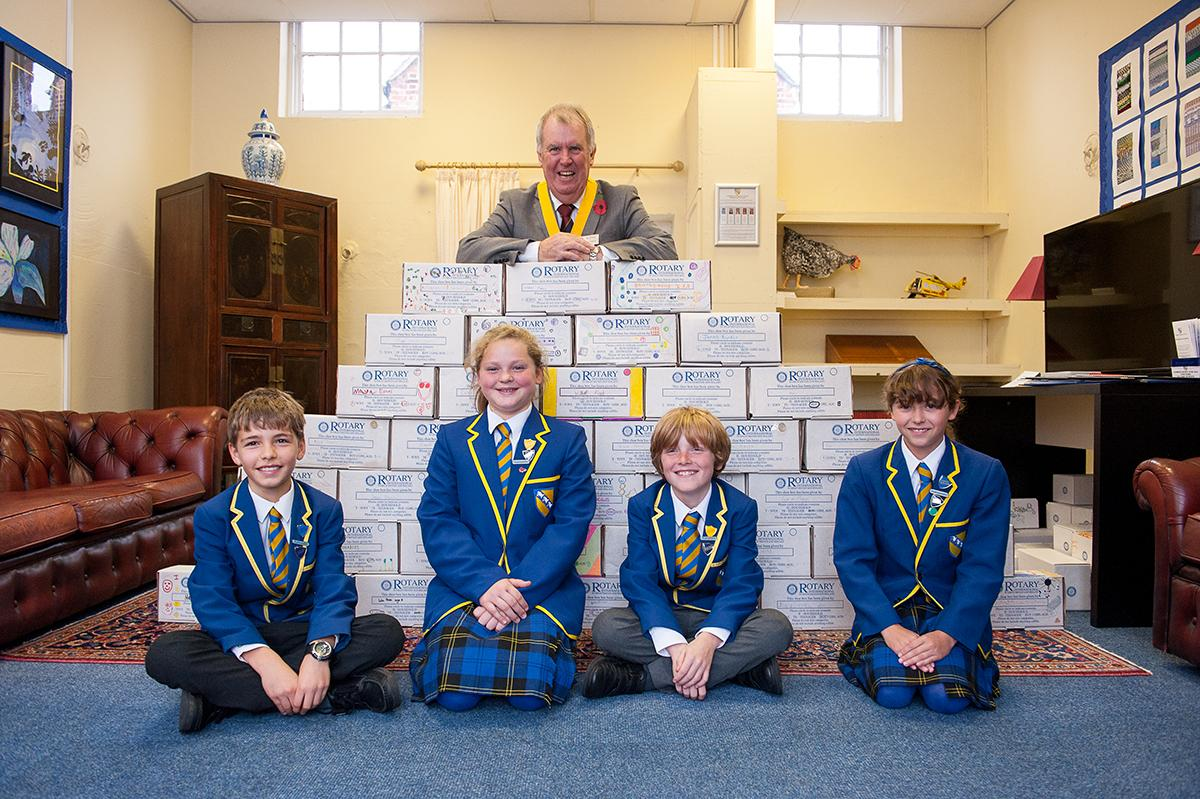 Halstead Rotary work with Pupils from St Margaret's School to fill Shoe Boxes