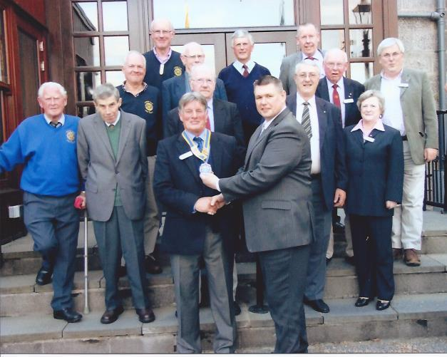 Our President, Hamish Thom, receiving the chain of office from Colin Watt surrounded by some of our members.