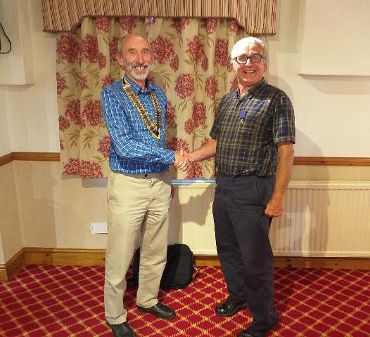 President Hywel receiving his Chain Of Office from Past President Kevin