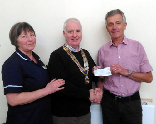 President Andy Carter presents the initial donation to  Dr Jonathan Nicoll and Sister Dawn Sanderson.