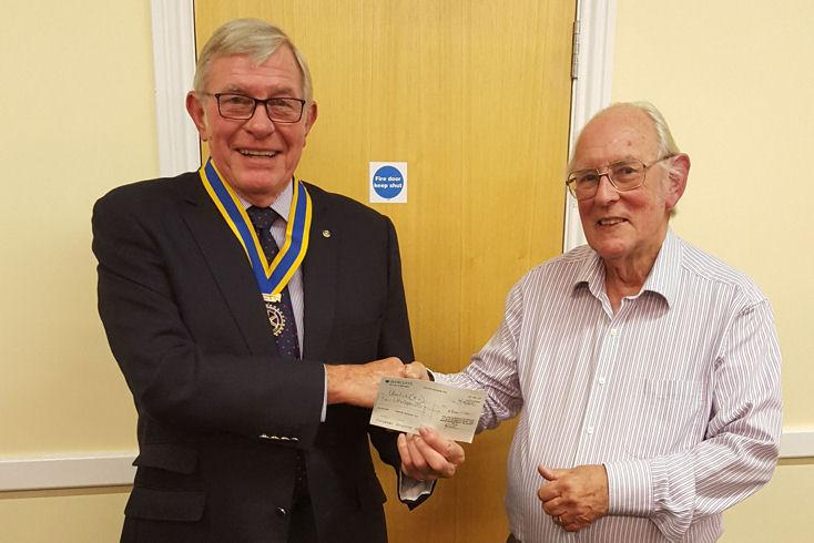 Club President Steve Knight presents a donation to David Tamcken