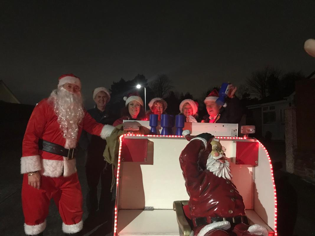 Santa, helpers and sleigh