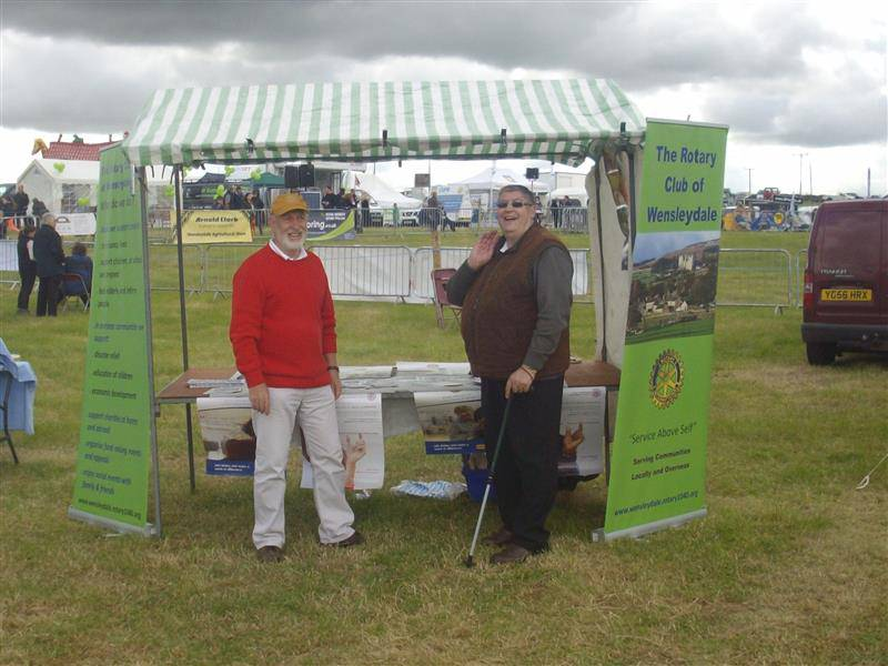 Rotary club presence at Wensleydale Show - IPP John Morton talks to a visitor