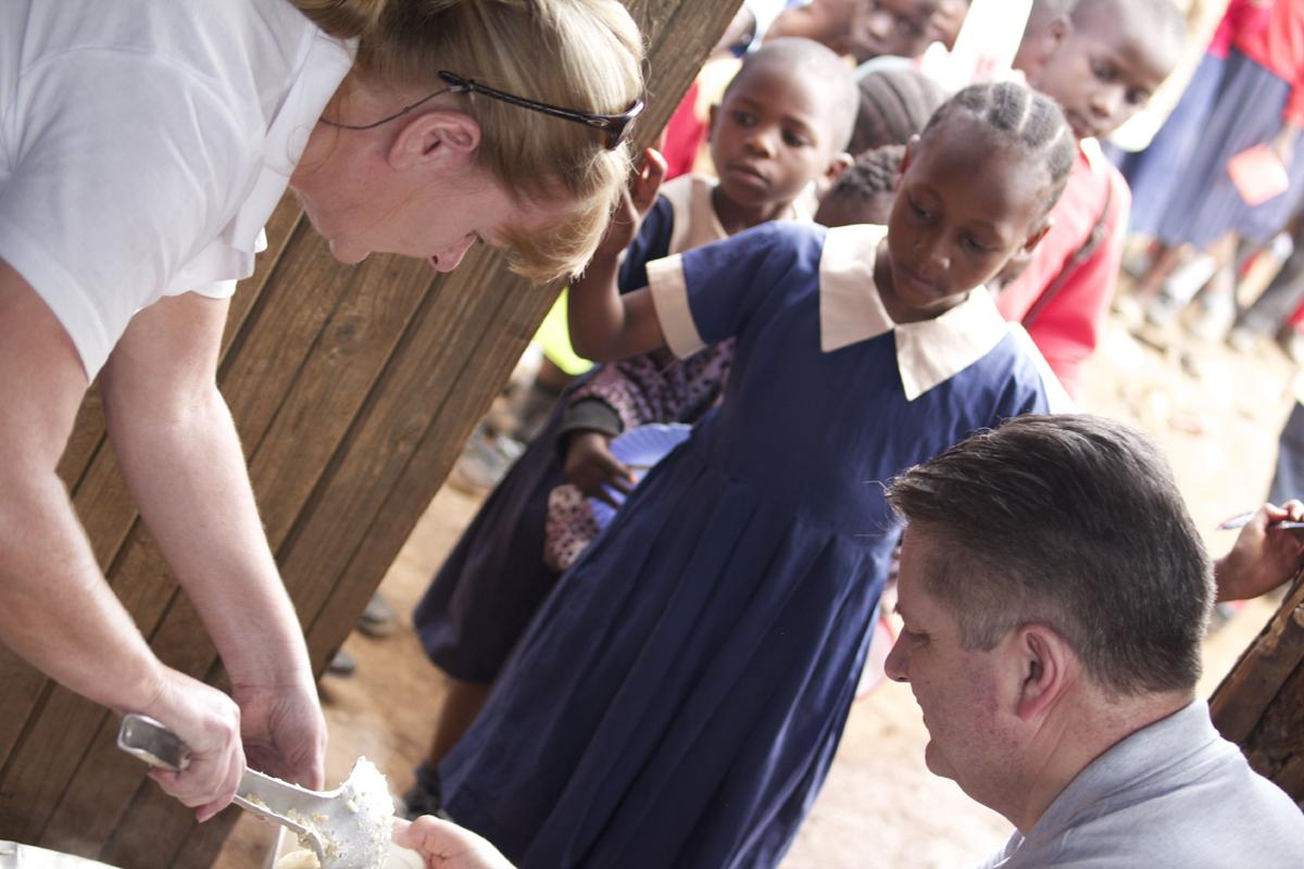 Eric & Irene Russell helping to feed some of the very hungry children in Kenya.