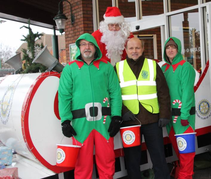 Santa visits Morrisons in Aldridge - Santa, his elves and Rotary helpers.