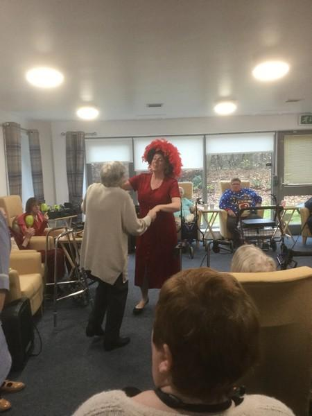 Dorset Gardens sheltered housing Christmas Party - Singer Sandra dancing with one of the ladies whilst singing