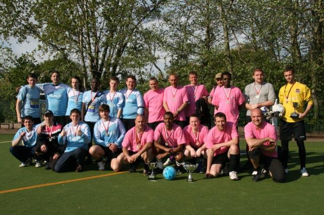 May 2012 Tommy McLafferty Football Tournament for Homeless communities - The runners up  and winning teams from Flack (blue) and Winter Comfort (pink) at the Abbey Leisure Complex after the trophy and medal presentations.