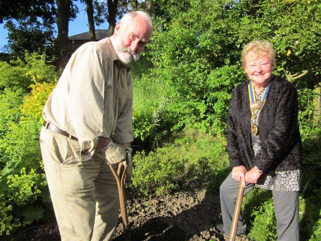 Oakworth Sensory Garden  - President Maxine with club member Duncan Clark get digging for the Jubilee planting