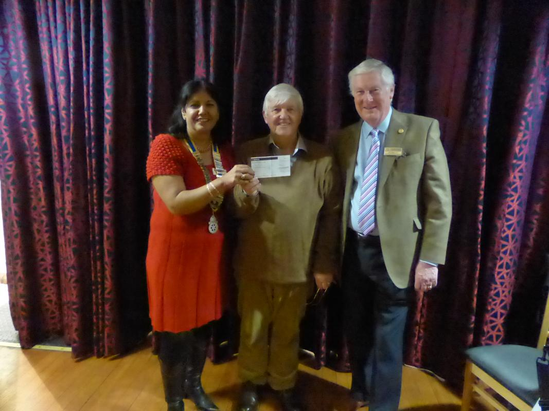 Tony Melia receive a cheque from President Jaz and Treasurer Ian to support the Bwengu Projects.